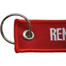 "Le Porte Clés - "" Remove Before Flight ""."